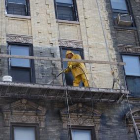 Workman power washing 188 Suffolk St, Lower East Side